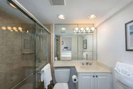 The bathroom with walk in shower.
