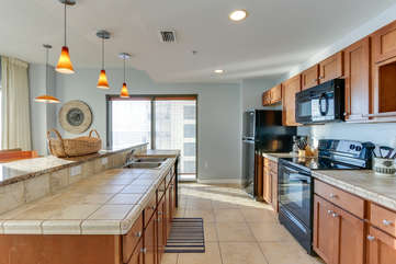 Fully stocked kitchen with most everything you would need to prepare a fabulous meal for the group.  Plenty of cabinet space and tiled countertops.