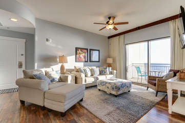 Living area with plenty of comfortable seating and a view of the Gulf of Mexico