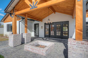 Welcoming designer entrance includes a fire pit for the cooler evenings