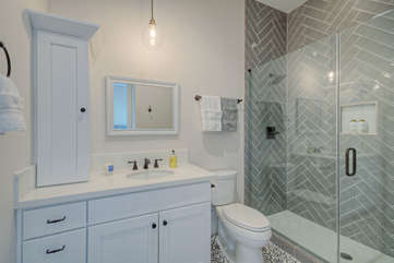 2nd bath features contemporary decor and newly tiled walk in shower