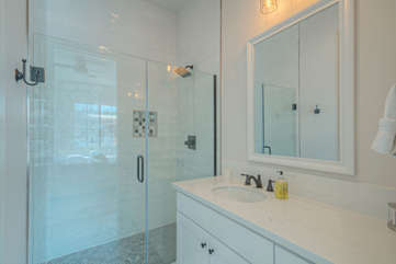 3rd bath has chic modern look and includes a walk in shower