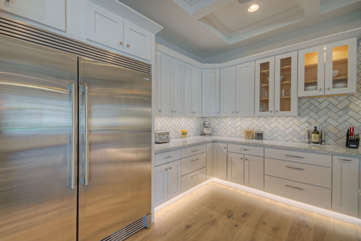 Toe kick lighting below cabinets adds to kitchen's bright and pleasing ambiance