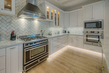 High end appliances include a Bertazzoni gas stove and microwave oven