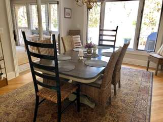 Dining room with seating for 8 and access to the screened porch/deck
