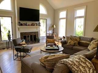 Great room with vaulted ceiling and wall mounted tv
