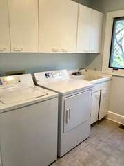 Full size washer/dryer in convenient laundry room