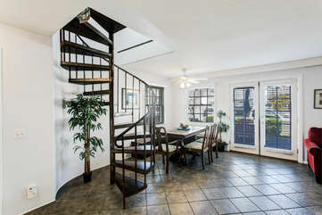 Dining nook and spiral staircase to the Master bedroom