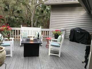 outside backyard patio with gas grill and fire table