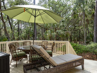 Expansive deck with ample seating and dining area