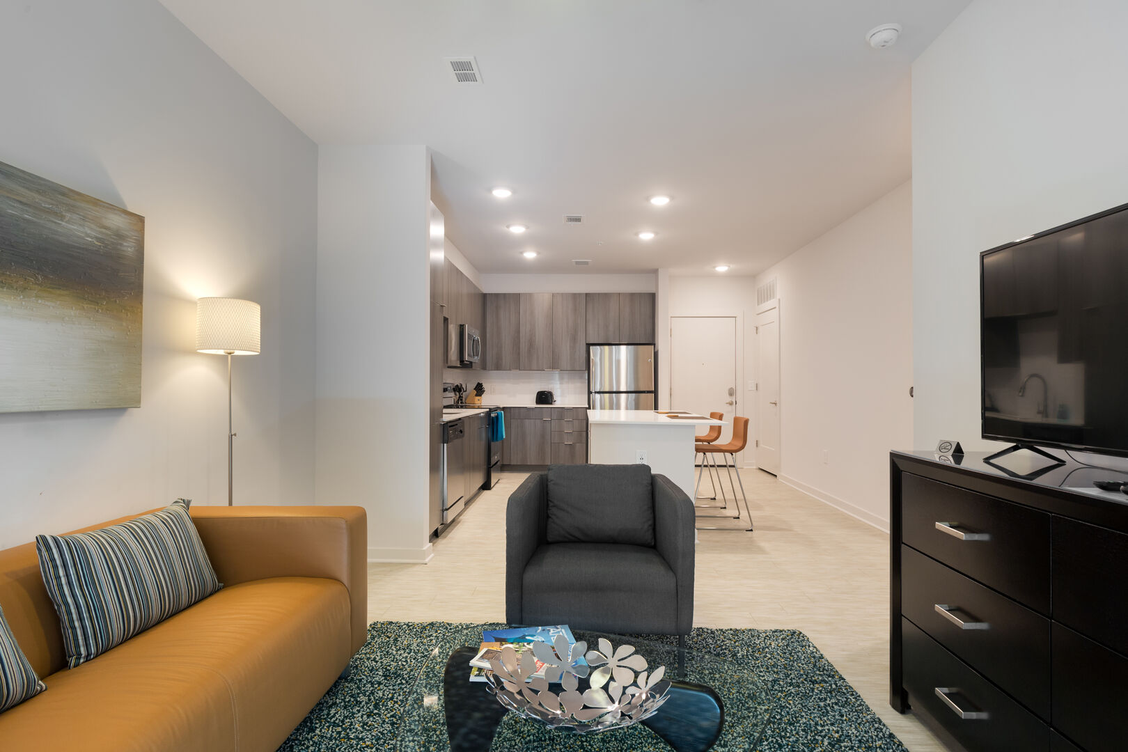 Contemporary Open Kitchen and Living Room - Corporate Apartments Near Me - 1-Bedroom Spectacular Suites