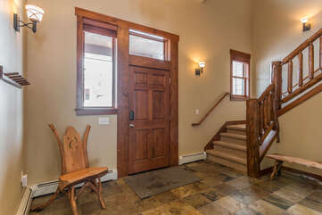 Entryway with hooks and bench seating