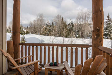 Take in mountain views from the Queen bedroom on upper level