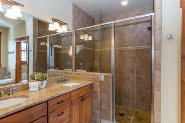 Ensuite master bathroom (upper level) with walk in shower & double sinks
