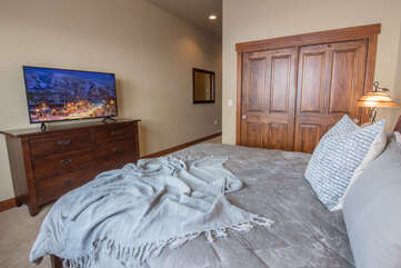 Relax with the Smart TV in the lower level master bedroom