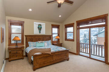 Escape to the upper level master bedroom with south valley views from the deck