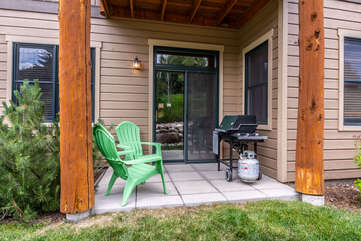 Private patio with gas grill and Adirondack seating