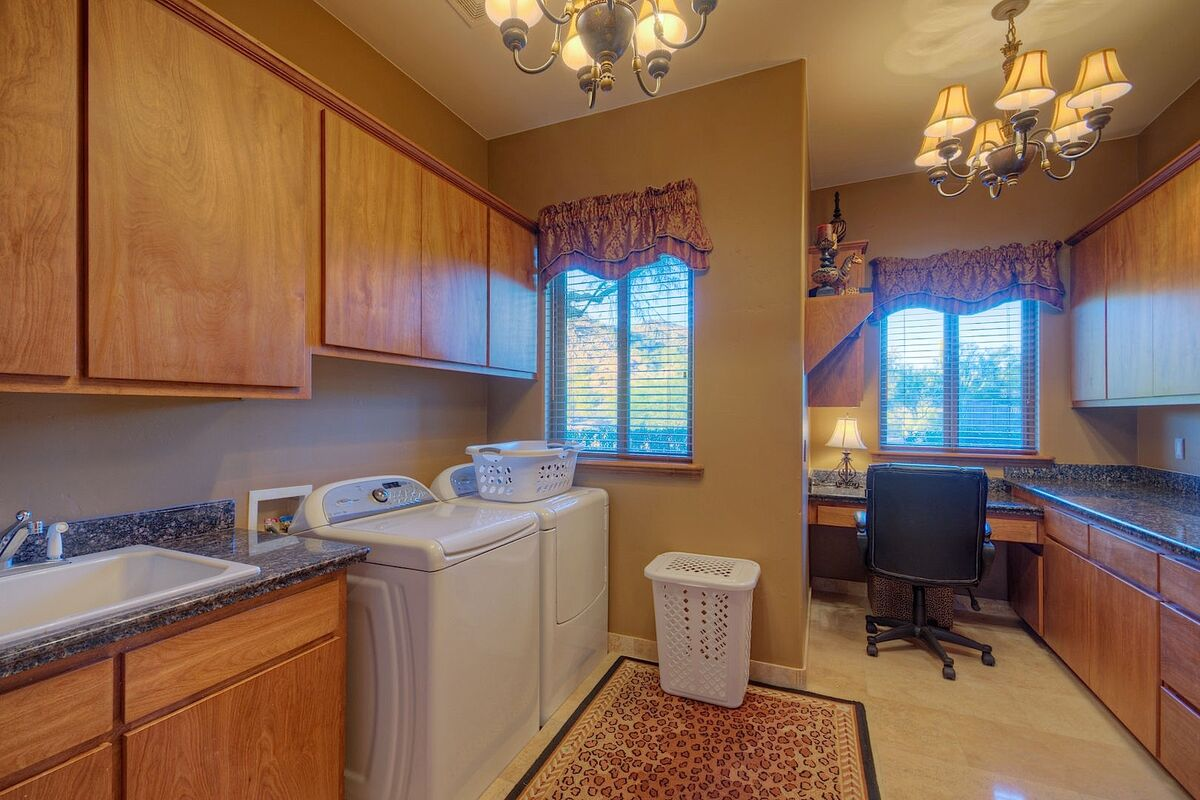 Laundry room with work station