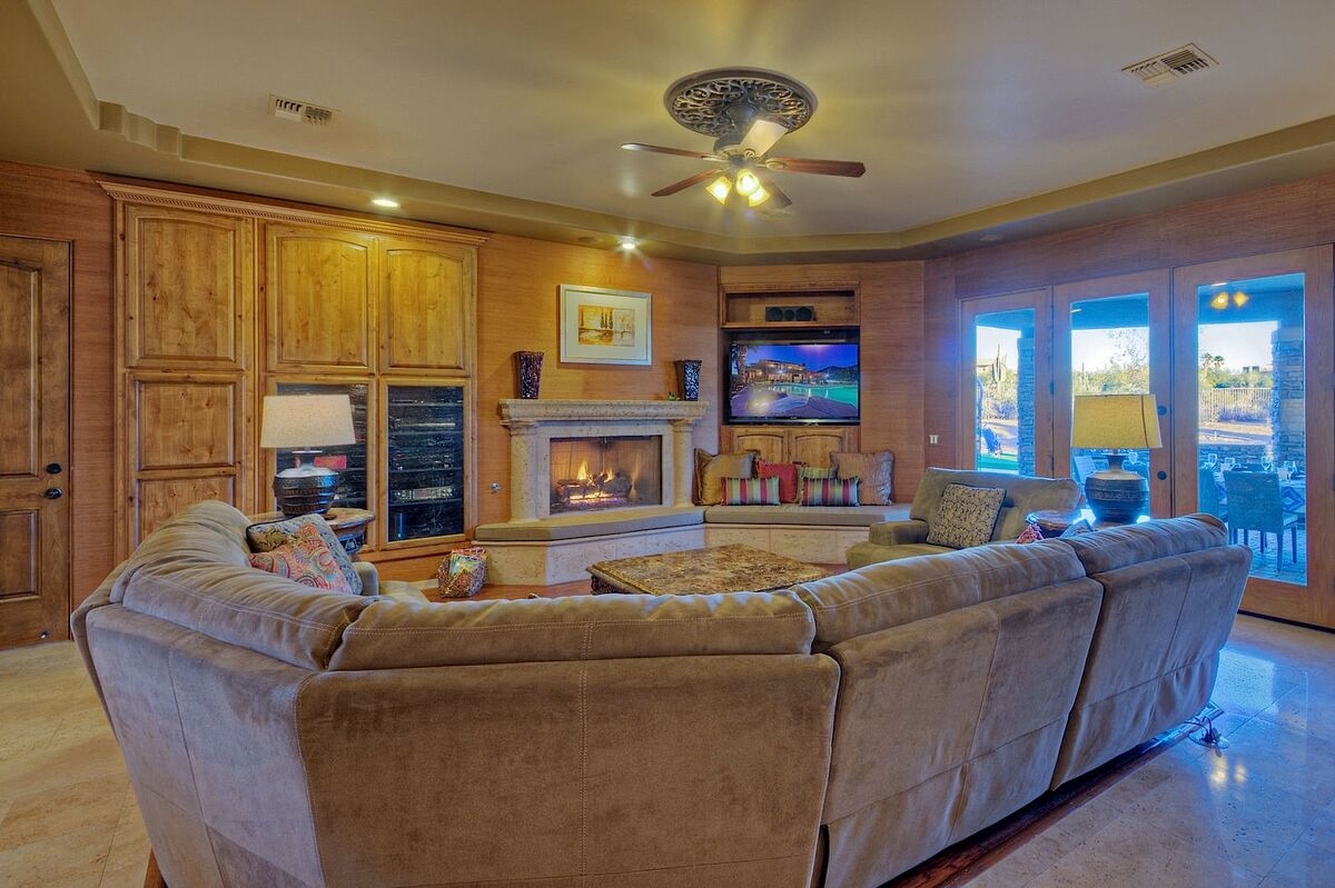 Large living room with flatscreen TV and fireplace