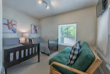 Lower level guest room - 2 twins and full size futon.
