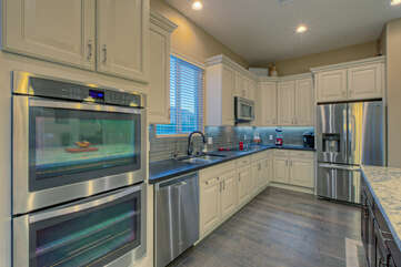Designer kitchen includes high end appliances and premium work space