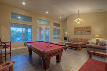 Demonstrate your best cue action in game room with appealing views of the backyard oasis