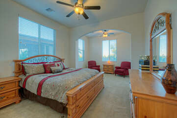 A king bed, sitting area and ceiling fan are appealing features of the casita's bedroom