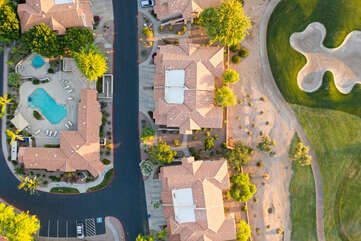 Birds eye view of community, condo and golf course