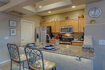 Modern kitchen has granite counter tops and newer stainless steel appliances