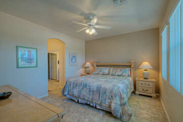 Spacious and well appointed primary suite includes a deluxe king bed and ceiling fan