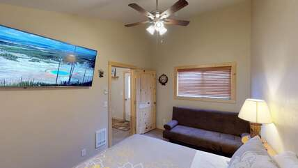 Second bedroom with a futon couch