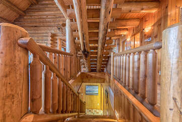Stairways are not lacking any detail, full log cabin feel every step of the way.