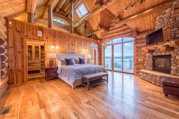 Master suite features a king bed, sliding glass doors with private access to the deck, complete with Adirondack seating right outside the doors.
