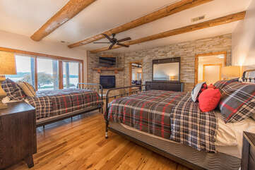 Full lodge feel, built in fire place, endless lake views.