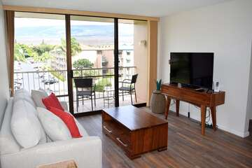 Living room opens to private lanai