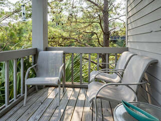 Covered deck off of living room area with views of tidal marsh