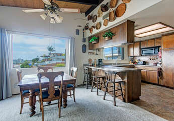 Dining area with wide windows and view of the ocean.