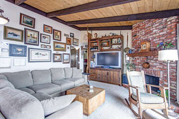 Living room with featured brick wall.