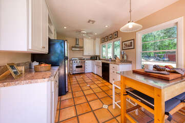 Updated country kitchen with Saltillo tiled floor and granite countertops