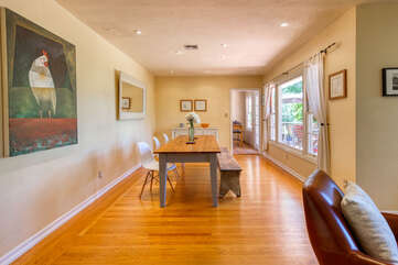 Oak floors, picture windows, open floor space —easy to move around