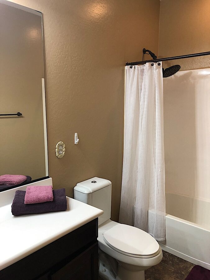 Guest bathroom with tub shower combo