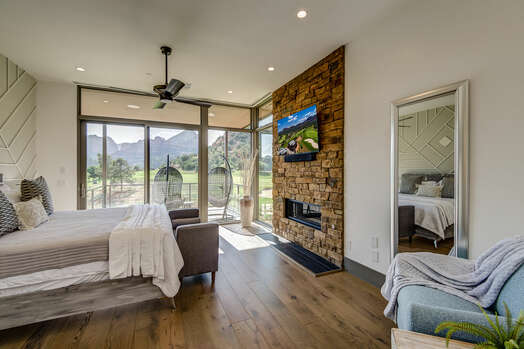 Master Bedroom with a King Bed, Stone Wall with a Gas Fireplace and 55