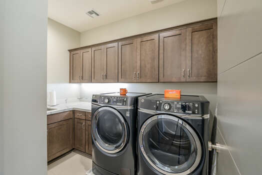 Laundry Room with Full Size Front Load Washer and Dryer