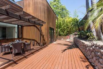 Outdoor deck area with large propane grill.
