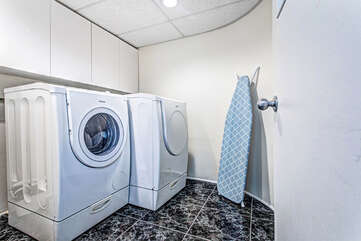 Lower level washer and dryer.