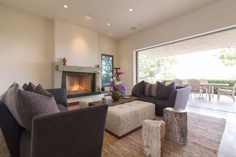 Living Room with fireplace. Glass doors provide seamless indoor/outdoor experience.