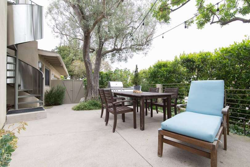 Side yard patio with extra seating.