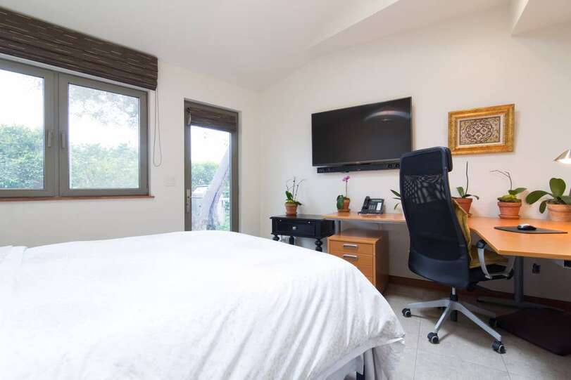 Guest  Bedroom #4 with desk space. Queen Bed.Private Patio just outside of the door.