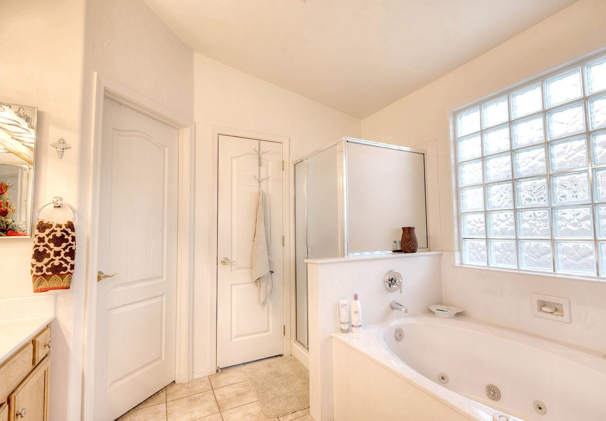 Bright and clean Master bath with Separate walk in shower and soaking tub