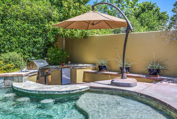 In Pool Seating and Covered BBQ Area